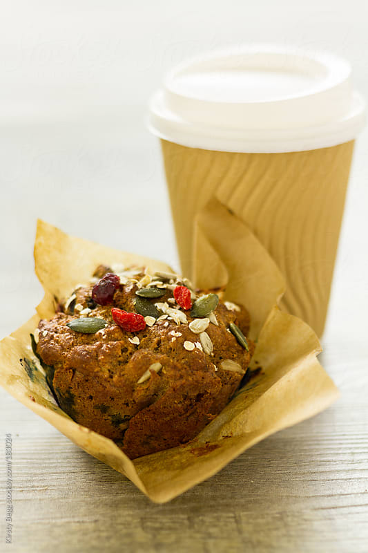 Blueberry muffin with coffee cup by Kirsty Begg for Stocksy United