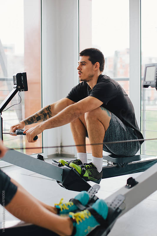 Man training on ergometer indoor by VeaVea for Stocksy United