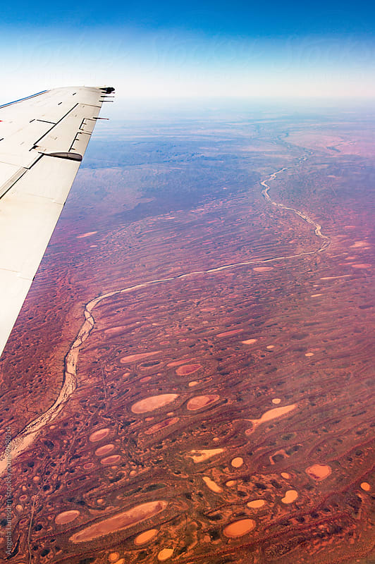 Red earth and dry river beds in the far north of Western Australia by Angela Lumsden for Stocksy United