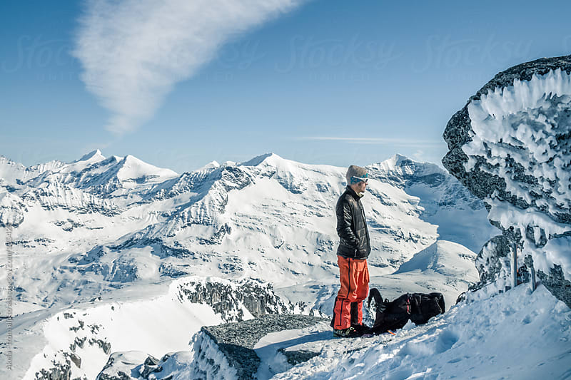 young freeskier in big mountain scenery by Leander Nardin for Stocksy United