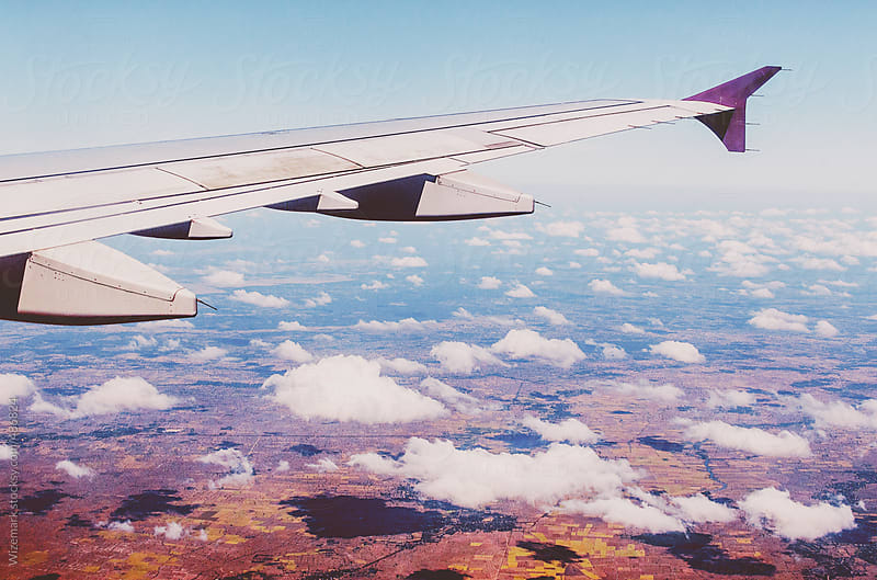 Airplane wing in flight by Wizemark for Stocksy United