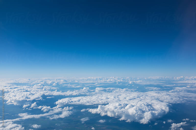 Cloudscapes from airplane by Peter Wey for Stocksy United