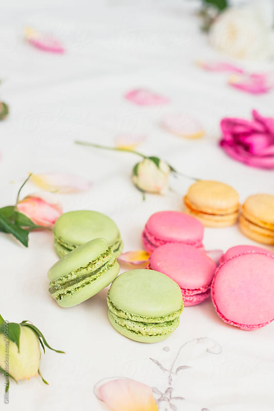 macarons and roses on an embroidered cloth by Gillian Vann for Stocksy United