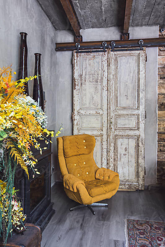 Armchair in a Vintage Flower Shop by Lumina for Stocksy United
