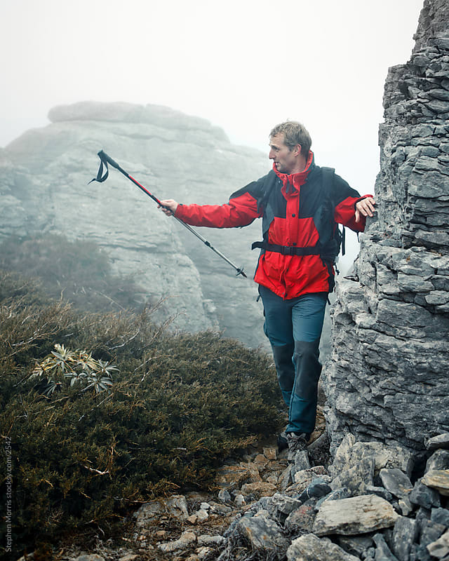 Hiker Showing the Way by Stephen Morris for Stocksy United