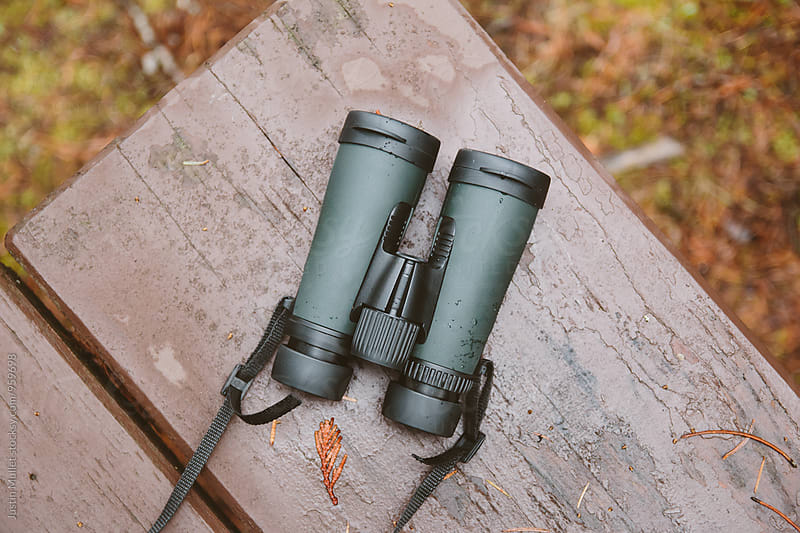 New binoculars laying on a picnic table by Justin Mullet for Stocksy United