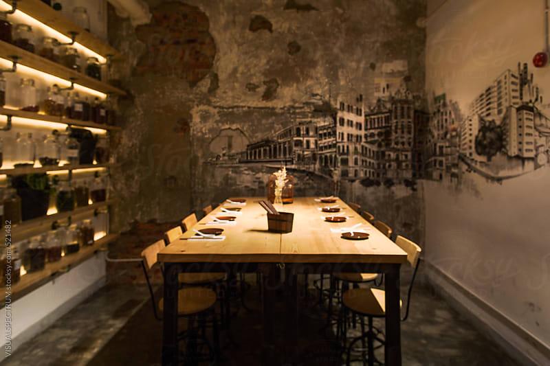 Set Table in Dark Trendy Restaurant Defocused by VISUALSPECTRUM for Stocksy United
