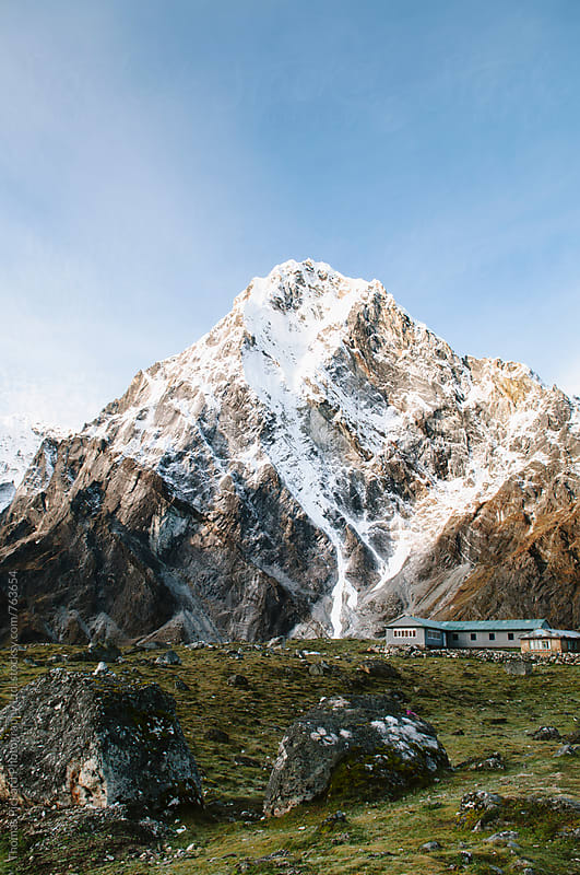Cholatse (6,443 metres) towers over tea houses at Dzonglha, Everest Region, Sagarmatha National Park, Nepal. by Thomas Pickard for Stocksy United
