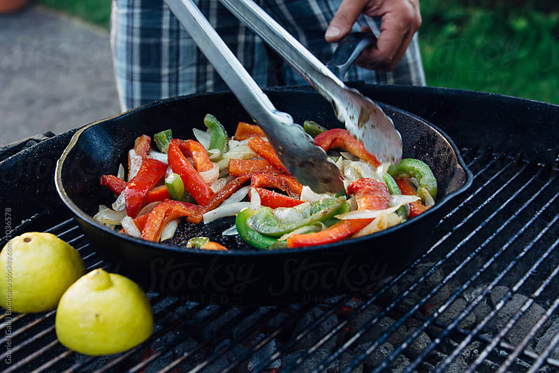 Peppers and onion in a cast iron pan by Gabriel (Gabi) Bucataru for Stocksy United