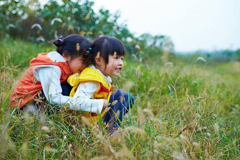two lovely little asian girl having fun outdoor by Bo Bo for Stocksy United