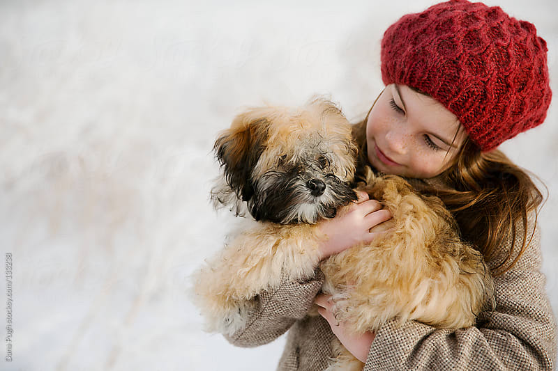 Girl and her puppy by Dana Pugh for Stocksy United