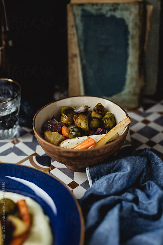 Roasted vegetables and fruit by Tatjana Zlatkovic for Stocksy United