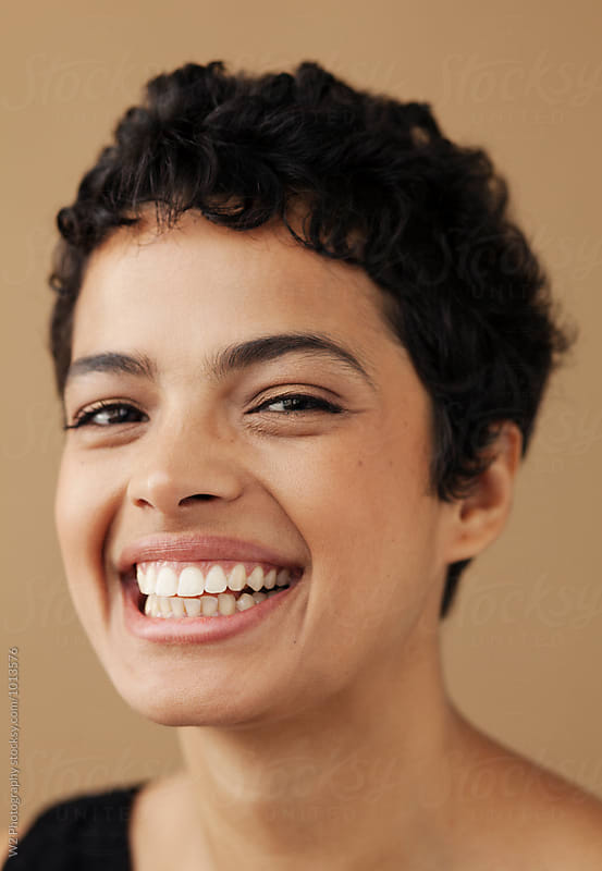 Close portrait of smiling woman. by W2 Photography for Stocksy United