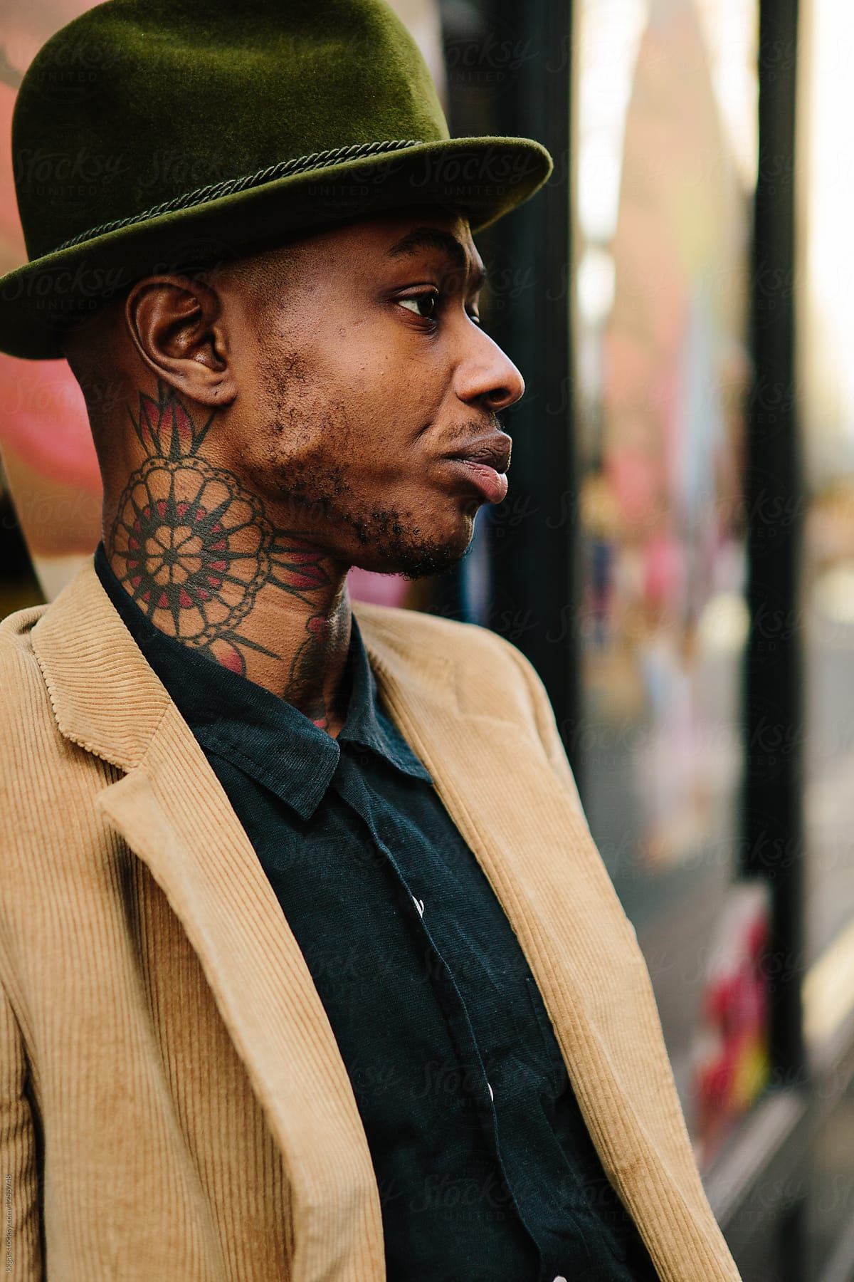 9562184af7487 Stylish young black man with tattoos and hat by kkgas for Stocksy United