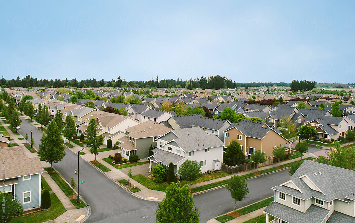 Aerial drone view of a suburban neighborhood by Mihael