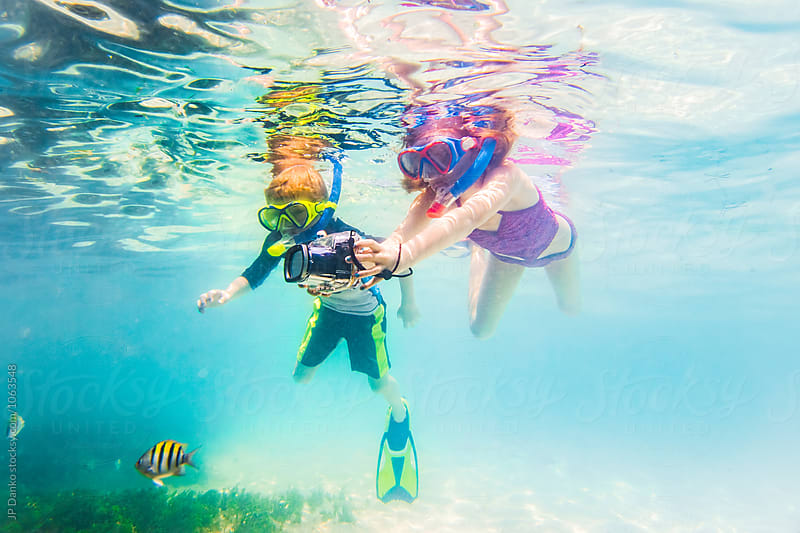 Boy and Girl Snorkeling On Tropical Reef In Cuba Caribbean Island With Underwater Camera by JP Danko for Stocksy United