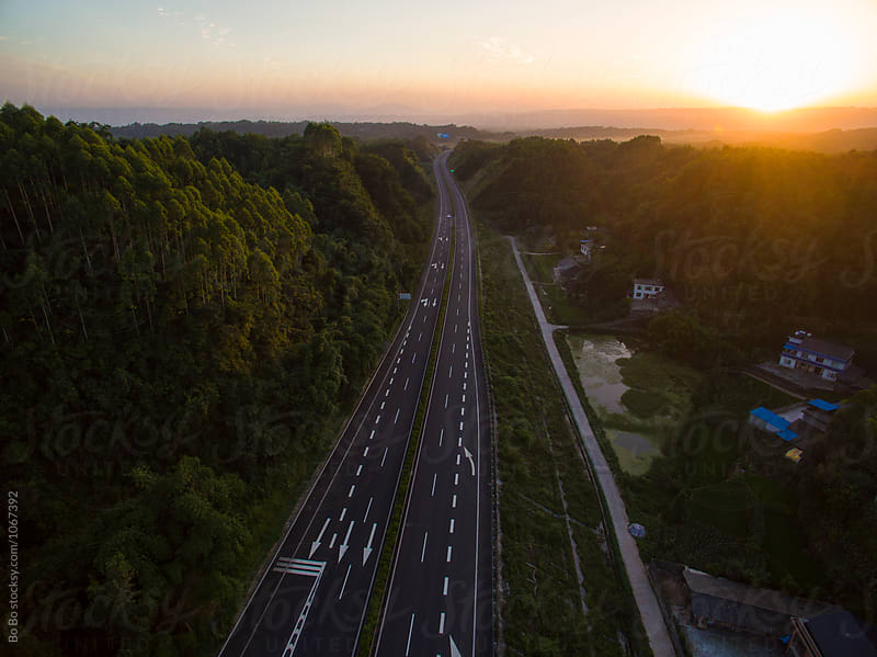 aerial view of highway at sunset by Bo Bo for Stocksy United