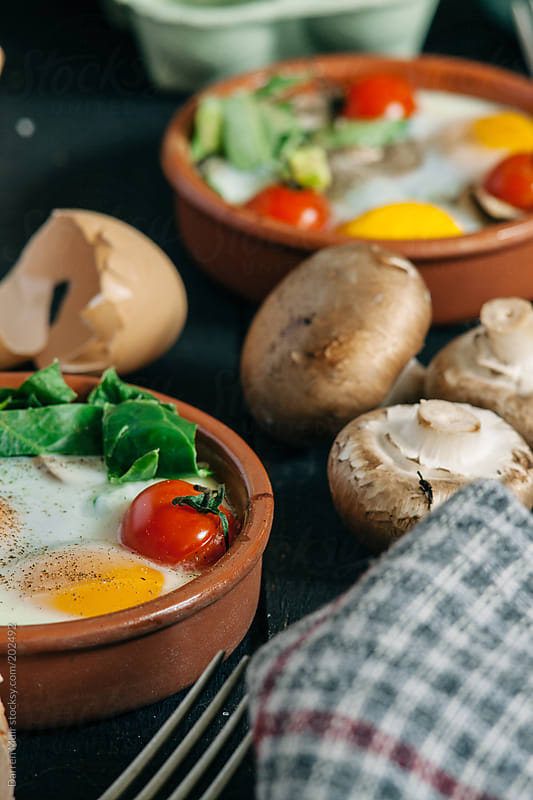 Baked eggs. by Darren Muir for Stocksy United