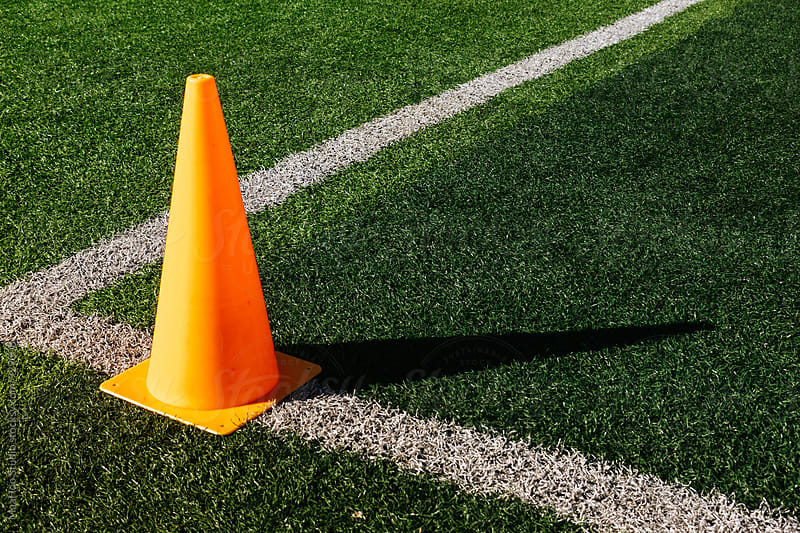 Cone on football field by Maa Hoo for Stocksy United