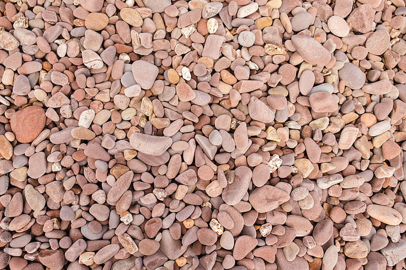 Lots of beach pebbles by Rebecca Spencer for Stocksy United