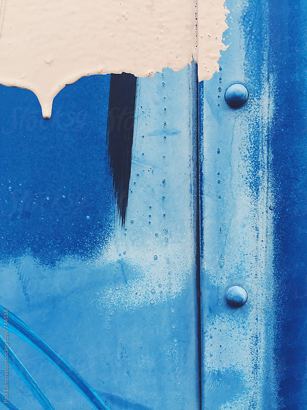 Beige and blue paint covering graffiti tags on mailbox, close up by Paul Edmondson for Stocksy United