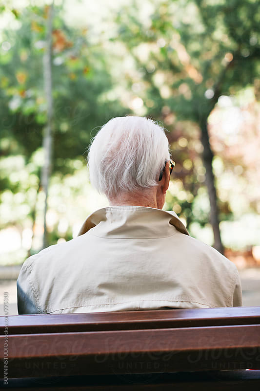 Back view of an elderly man sitting on a bench. by BONNINSTUDIO for Stocksy United