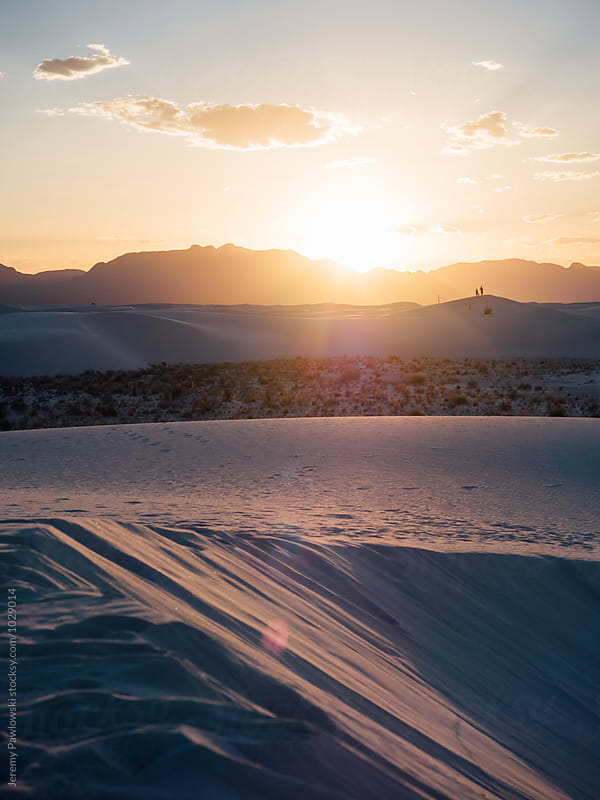 Sunset behind mountains in White Sands, New Mexico by Jeremy Pawlowski for Stocksy United