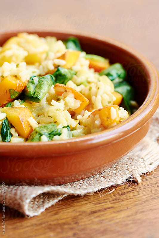 Risotto with Red Kuri Squash and Spinach by Harald Walker for Stocksy United