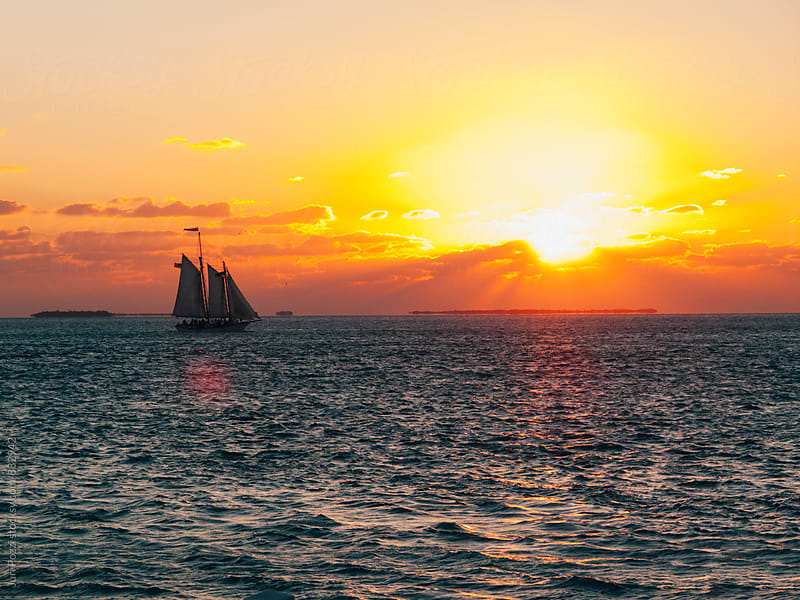 sailboat at sunset in Florida Keys by Juri Pozzi for Stocksy United