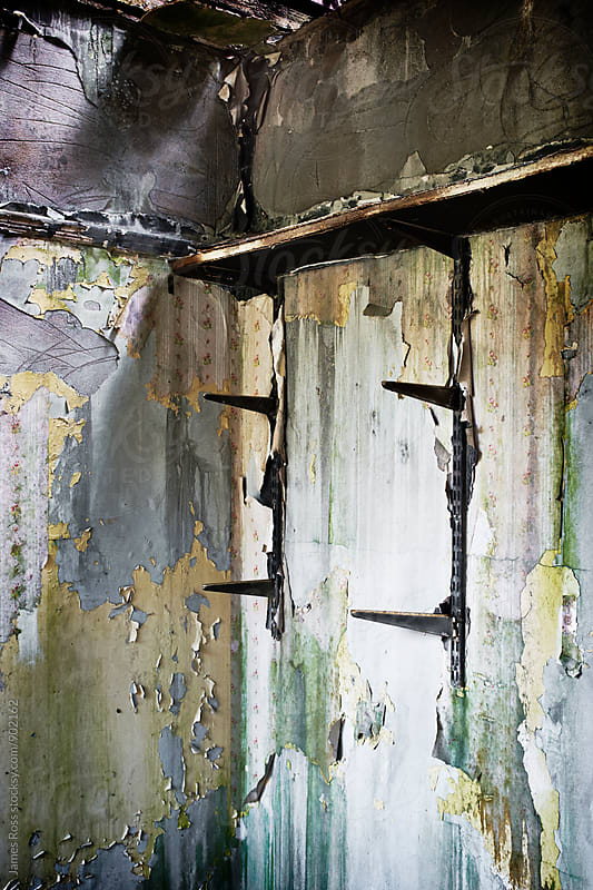 Inside a fire damaged room by James Ross for Stocksy United