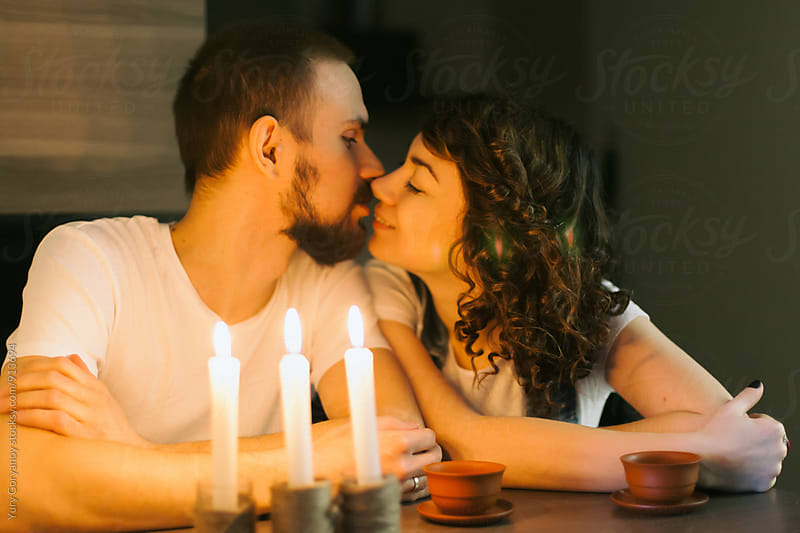 Portrait of kissing couple by Yury Goryanoy for Stocksy United