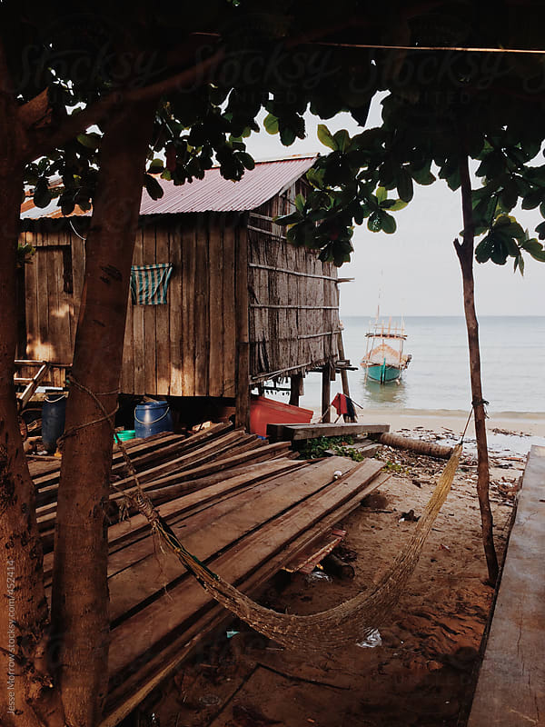 Small fishing boats in water on tropical island in Asia by Jesse Morrow for Stocksy United