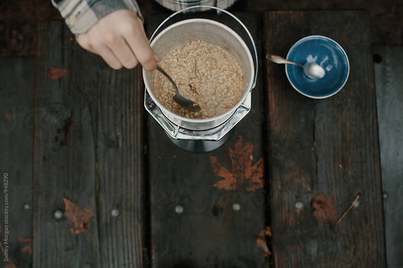 Oatmeal on a Camp Stove by Sidney Morgan for Stocksy United