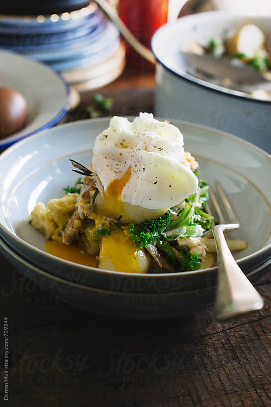 Smoked mackerel and kale salad with a poached egg. by Darren Muir for Stocksy United