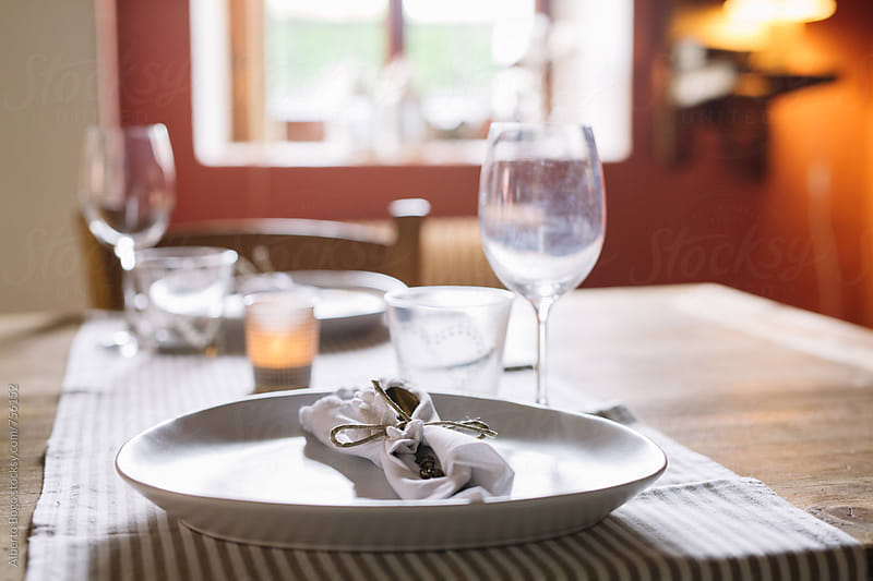 Simple table setting at home by Alberto Bogo for Stocksy United