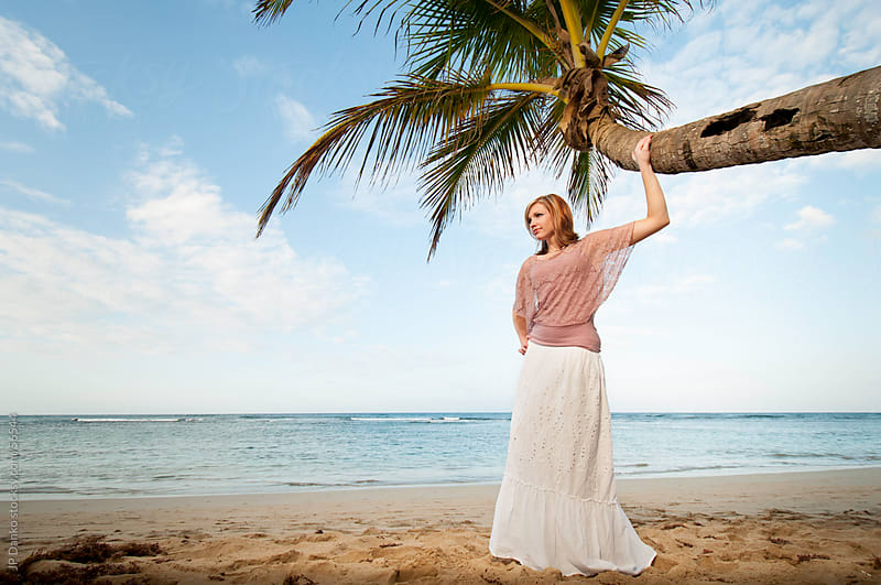 Beautiful Woman on a Tropical Beach With Palm Tree by JP Danko for Stocksy United