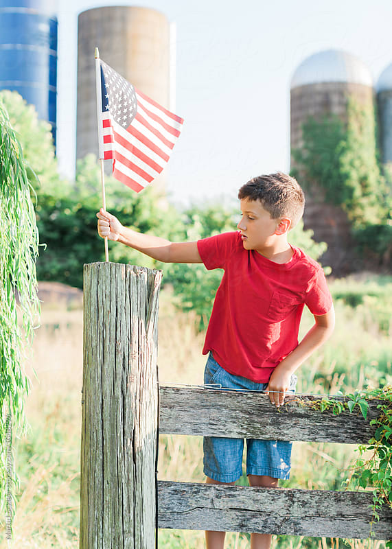 Boy Saluting with American Flag by Marta Locklear for Stocksy United