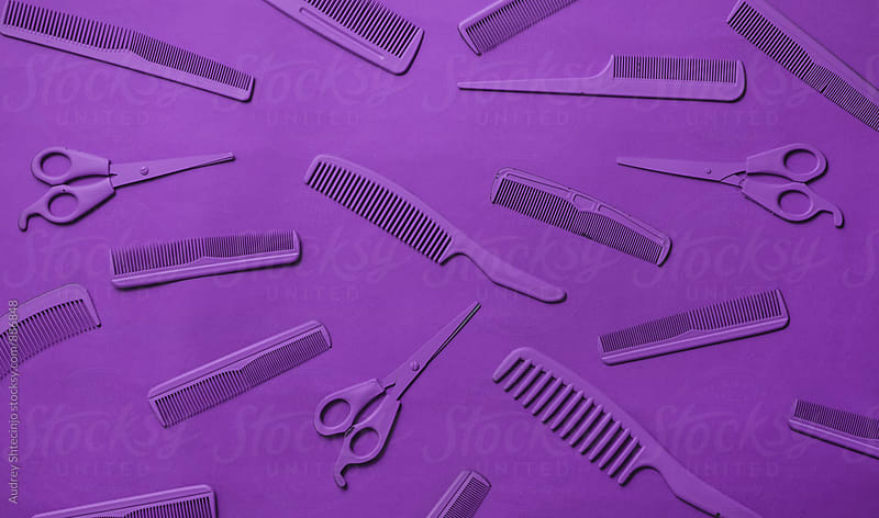 Various hairdresser tools in purple color on purple background. by Marko Milanovic for Stocksy United