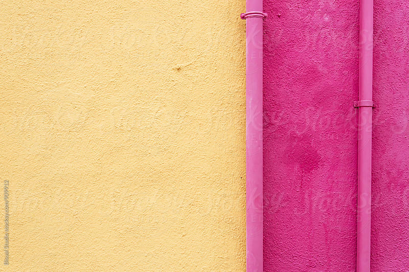 Pink pipe on yellow and pink wall by Bisual Studio for Stocksy United