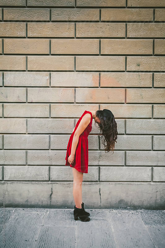 Asian Woman in Red Dress Before Flipping Her Hair by Giorgio Magini for Stocksy United