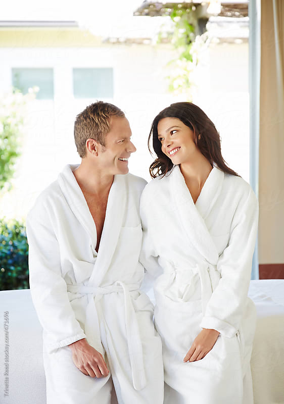 Beautiful couple relaxing at a luxury spa by Trinette Reed for Stocksy United