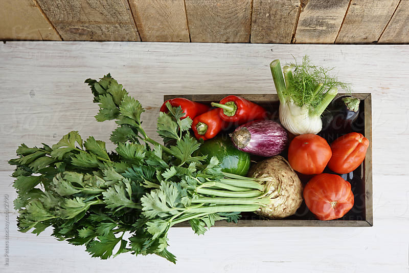 Vegetables in a crate by Ina Peters for Stocksy United