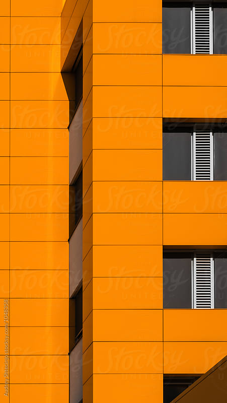 Detail of  facade on orange building. by Audrey Shtecinjo for Stocksy United