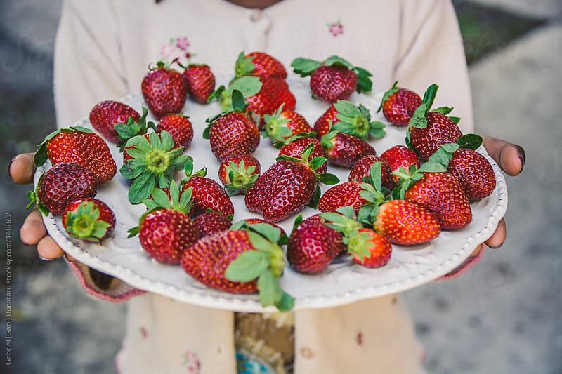 Girl With Strawberries by Gabriel (Gabi) Bucataru for Stocksy United