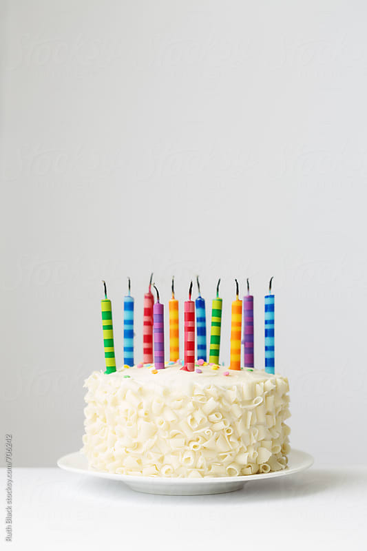 Birthday cake with blown out candles by Ruth Black for Stocksy United