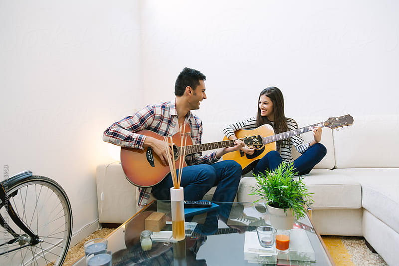 Couple Playing Acoustic Guitar at Home by Victor Torres for Stocksy United