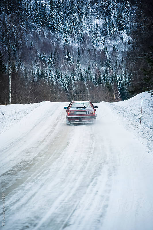 Car driving on the road with snow during winter by WAVE for Stocksy United
