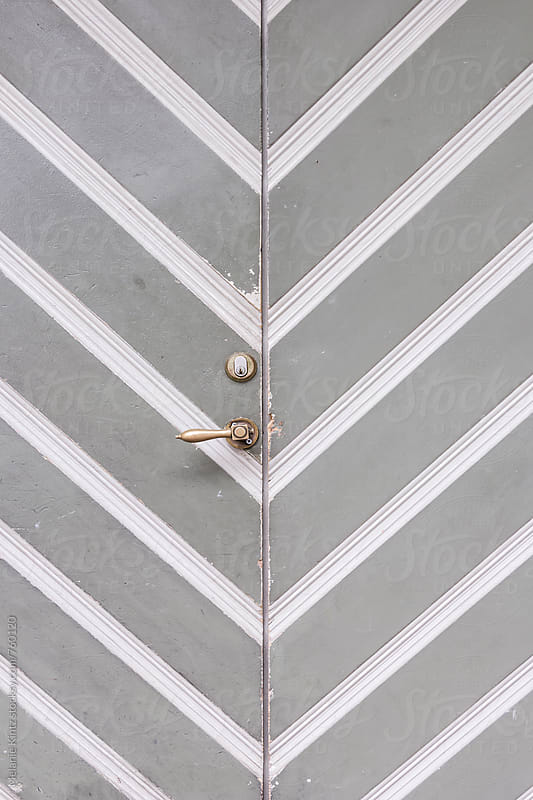 Grey door with diagonal pattern by Melanie Kintz for Stocksy United