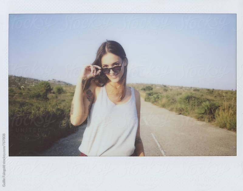 happy woman walking through a road by Guille Faingold for Stocksy United