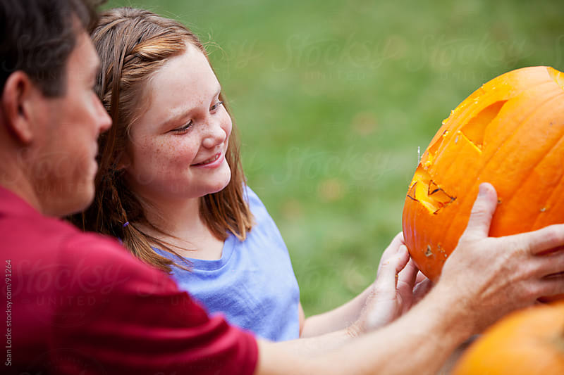Pumpkins: Daughter Happy With Carved Pumpkin by Sean Locke for Stocksy United